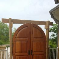 Arched Wooden Reveal Doors